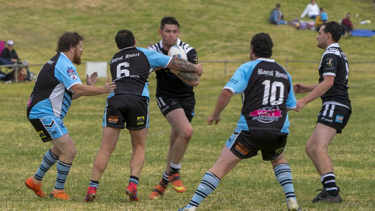 HIT UP: Jack Miller is greeted by the Guyra defence. Photo: Andrew Hoggan.