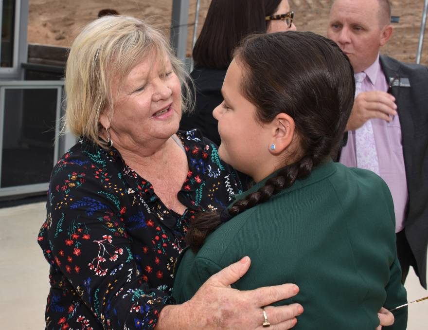 Glen Innes mayor Carol Sparks says hello to a student at her rebuilt local primary school.