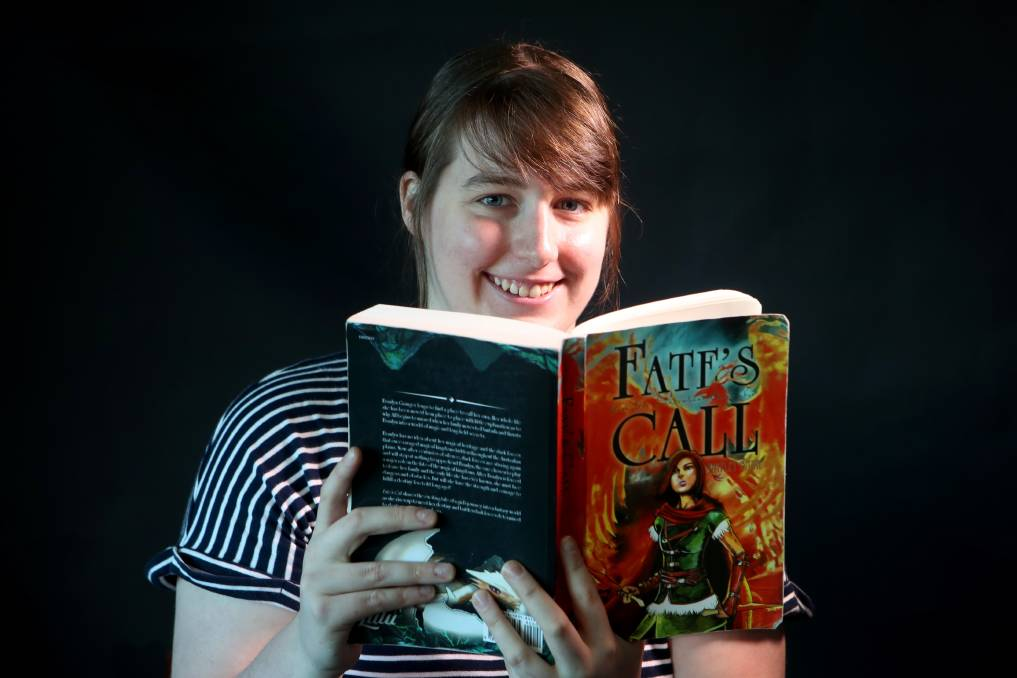 PERSISTENCE PAYS: Hayley Barr with her first novel, Fate's Call. Ms Barr spent the past decade writing and refining her book, before it was finally published. Picture: Sylvia Liber.