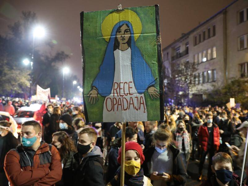 Thousands have marched in Polish cities in protest at tightening restrictions on abortion.